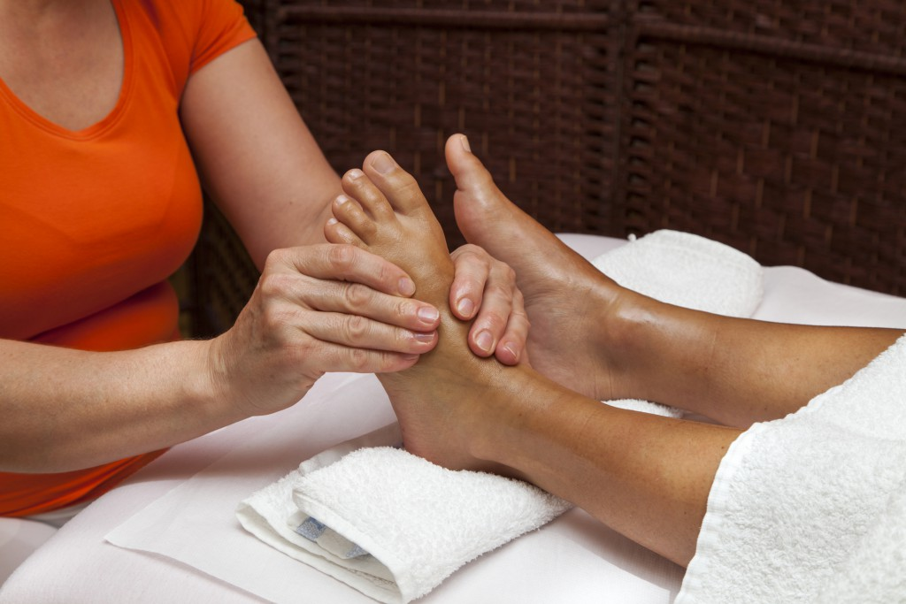 http://www.dreamstime.com/royalty-free-stock-images-professional-relaxing-foot-massage-various-techniques-woman-receiving-leg-lying-towel-awarded-health-center-image35489379